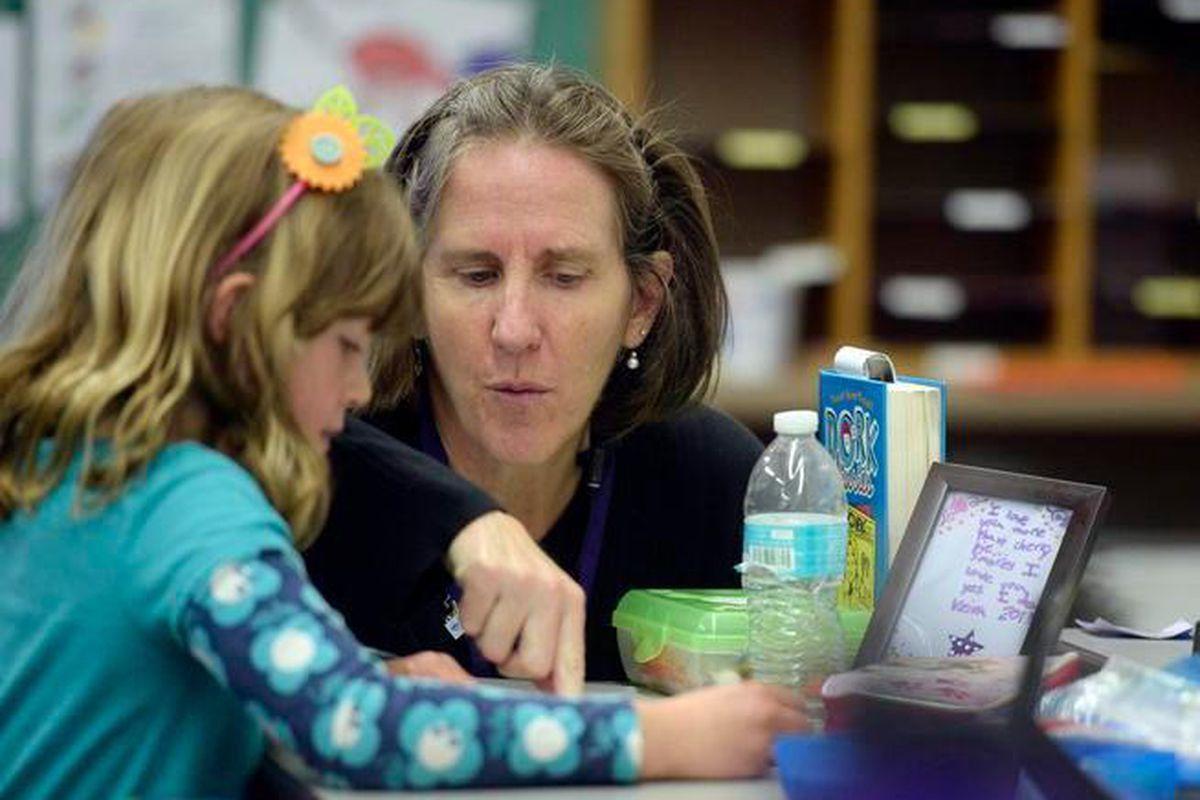 Brown International Academy teacher Kate Tynan-Ridgeway works with a student.