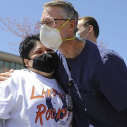 Ana Lucio, who was fighting COVID-19 on a ventilator this time last year, hugs Lakeview Hospital progressive care unit nurse mentor Paul Griffith, who transferred Lucio into the intensive care unit and helped translate for her to let her know what was going to happen, as they gather for an Alex Boyé concert in Bountiful on Tuesday, May 4, 2021. Lucio was in the hospital for more than two months and was Lakeview's longest COVID-19 admission. She was discharged in May 2020.