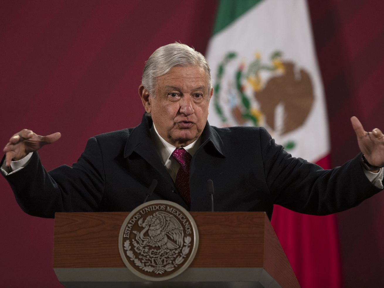 FILE - In this Dec. 18, 2020 file photo, Mexican President Andres Manuel Lopez Obrador gives his daily, morning news conference at the presidential palace, Palacio Nacional, in Mexico City. Mexico President Andrés Manuel López Obrador says he has tested positive for COVID-19 and is under medical treatment, Sunday, Jan. 24, 2021. (AP Photo/Marco Ugarte, File)