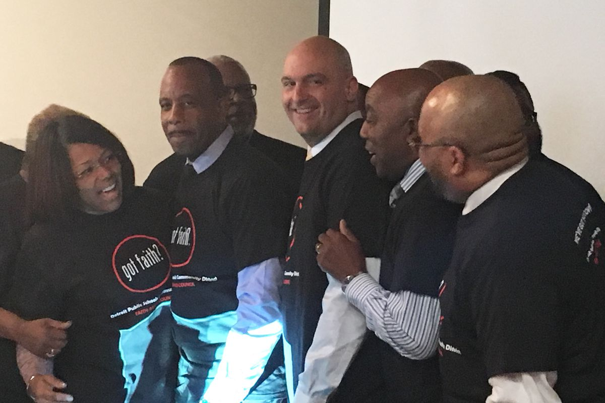 """Superintendent Nikolai Vitti surrounded by religious and district leaders wearing new """"Got Faith?"""" shirts."""