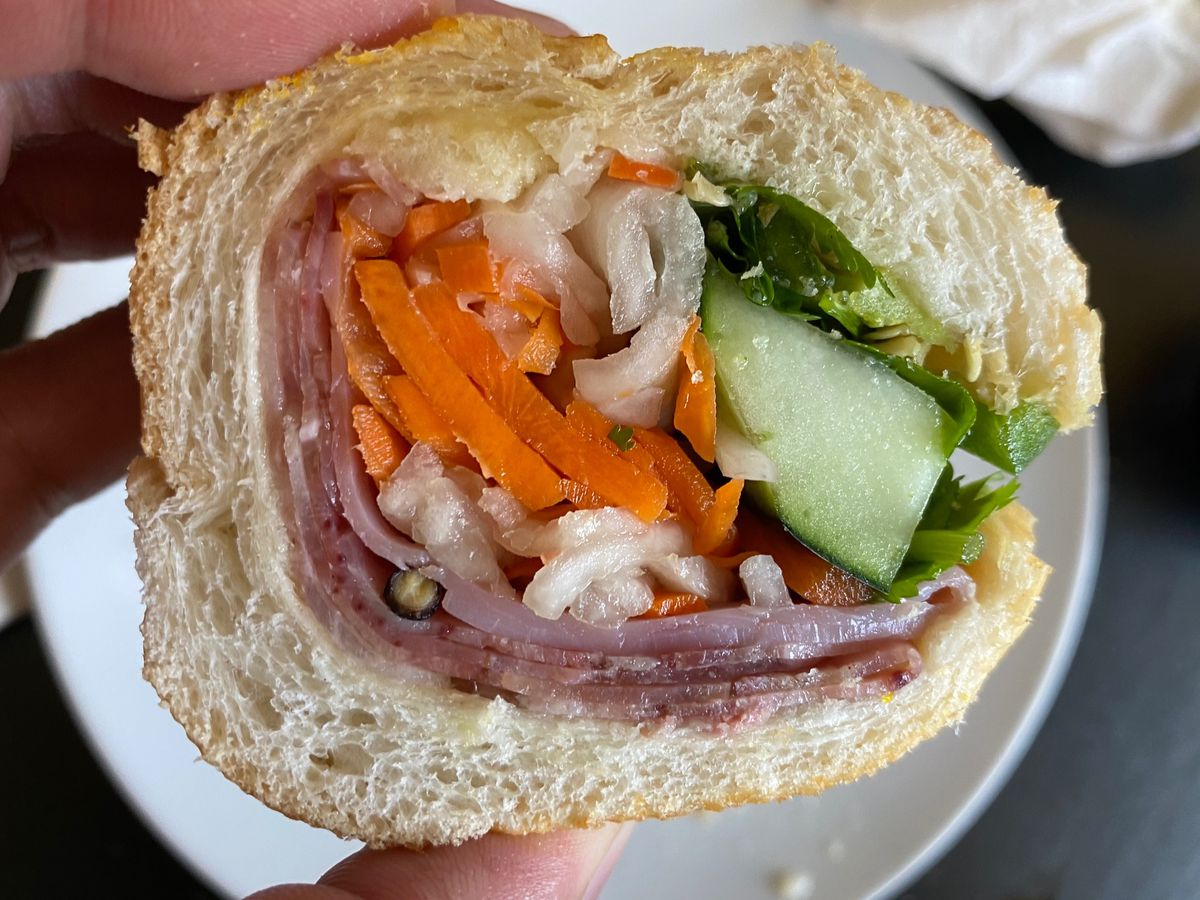 Cross section of a banh mi from Banh Mi Ba Le in El Cerrito, with cold cuts, pickled carrots and daikon, cucumber, and cilantro
