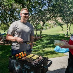 Jacob Anderson and his wife, Sam Anderson, grill with friends and family at Rock Canyon Park in Provo on Saturday, July 4, 2020.