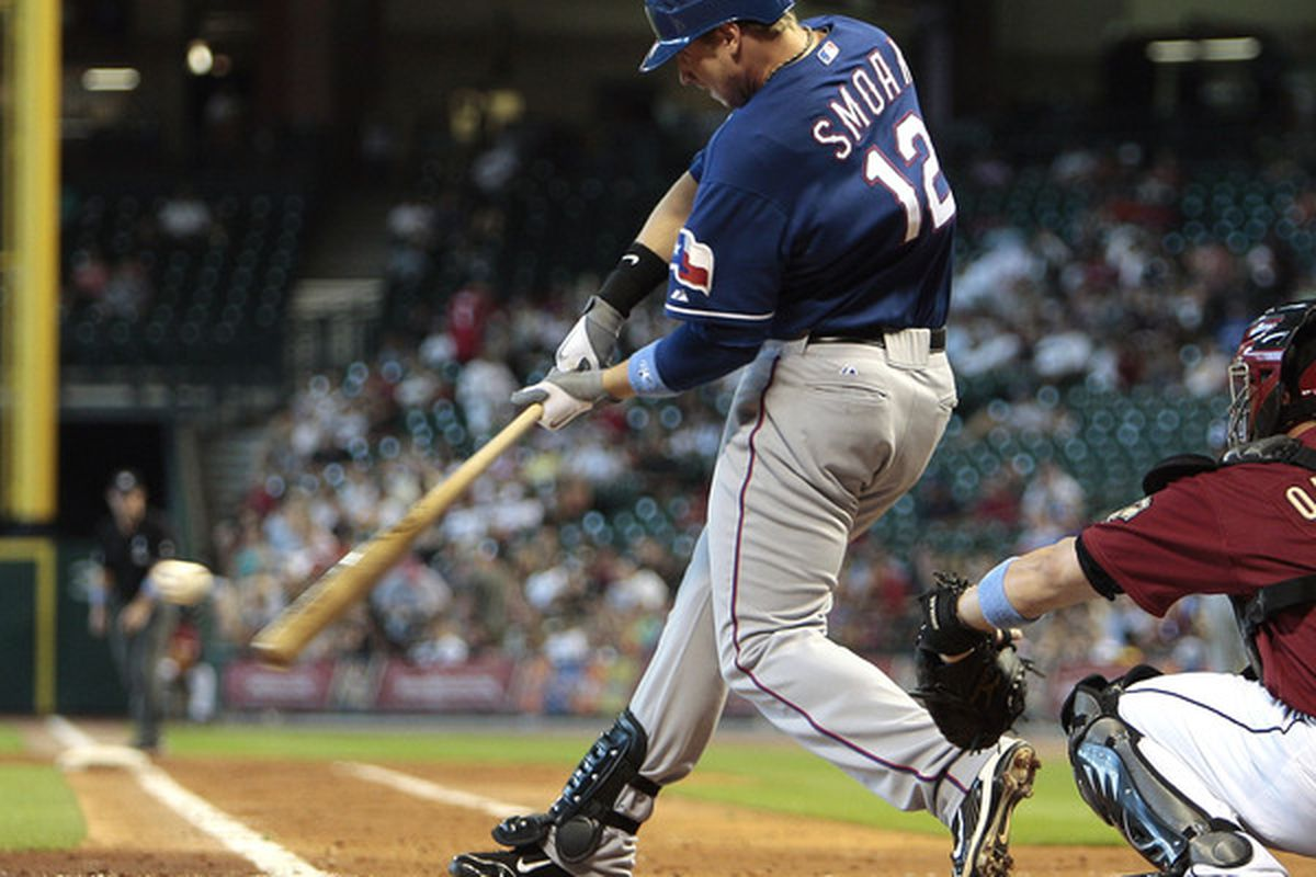 HOUSTON - JUNE 20:  Justin Smoak #12 of the Texas Rangers doubles in the second inning against the Houston Astros at Minute Maid Park on June 20, 2010 in Houston, Texas.  (Photo by Bob Levey/Getty Images)