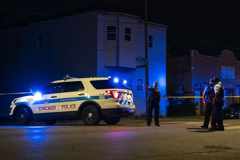 Officers block the 11700 block of South Michigan late Sunday for a shooting investigation.