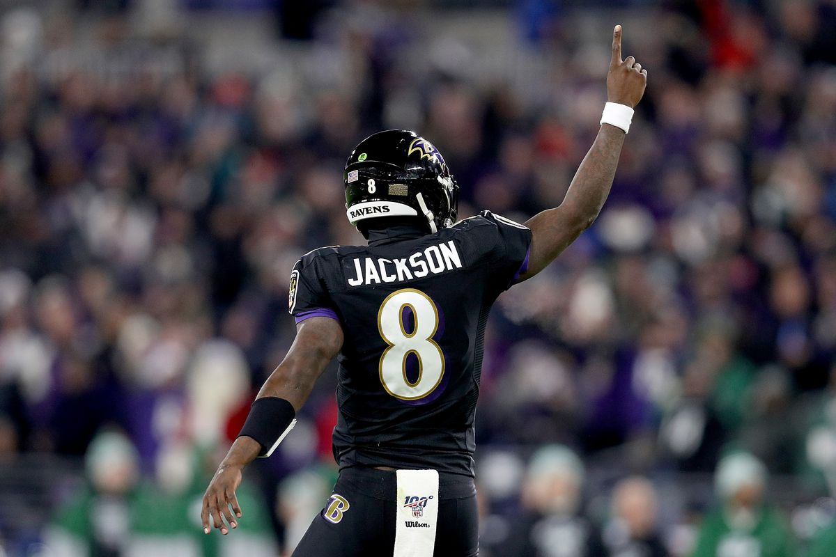 Quarterback Lamar Jackson #8 of the Baltimore Ravens gestures after a touchdown in the first quarter of the game against the New York Jets at M&T Bank Stadium on December 12, 2019 in Baltimore, Maryland.