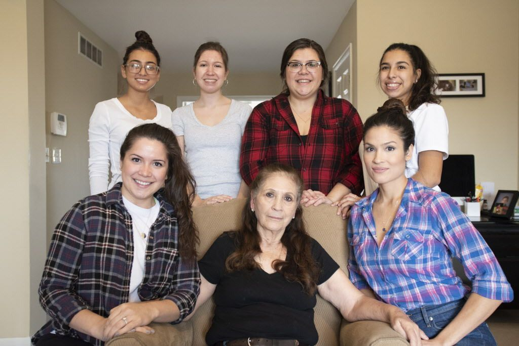 Elodia Esquinca (center) sits with a few of her granddaughters: Isabella Ospina, Adilene Esquinca, Evelyn Sandoval and Carolina Ospina (top left to right), Mariana Aldaba (bottom left) and Griselda Valadez (bottom right) in Aurora on Dec. 16, 2018.   Coli