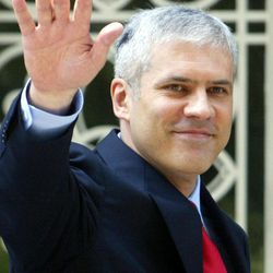 FILE - July 11, 2004 file photo of Serbia's first democratic president Boris Tadic, as he waves to supporters after taking his oath of office in the parliament building and stepping into the Serbian presidency building for an inauguration ceremony, in Belgrade, Serbia. Tadic said Wednesday April 4 2011  that he is resigning, paving the way for an early presidential election where he will face a strong challenge from a nationalist candidate. In the presidential vote, Tadic will be challenged by nationalist candidate Tomislav Nikolic who has received tacit support from Russia.