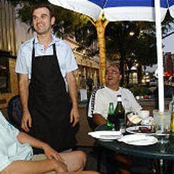 Miro Bako, second from left, owner of the Atlantic Cafe in Salt Lake, brings appetizers to Mladen Maric, president of the Salt Lake Bosnian Association; Edin Churic, vice president; and Sanita Sladojevic, secretary.