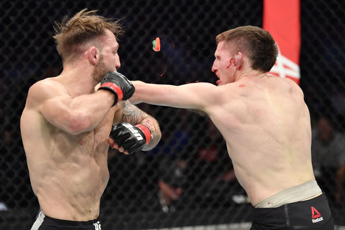 Jamie Mullarkey of Australia punches Brad Riddell of New Zealand in their lightweight fight during the UFC 243 event at Marvel Stadium on October 06, 2019 in Melbourne, Australia.