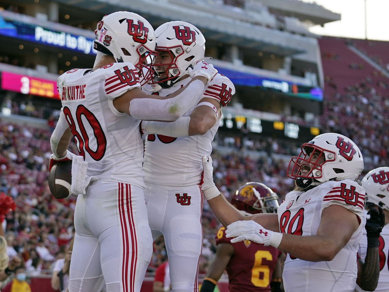 Utah tight end Brant Kuithe (80) celebrates his touchdown with wide receiver Britain Covey during game against USC.