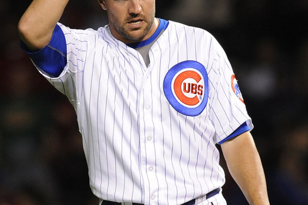 Blake Parker of the Chicago Cubs reacts after giving up two runs in the eighth inning against the Philadelphia Phillies at Wrigley Field in Chicago, Illinois.  (Photo by David Banks/Getty Images)