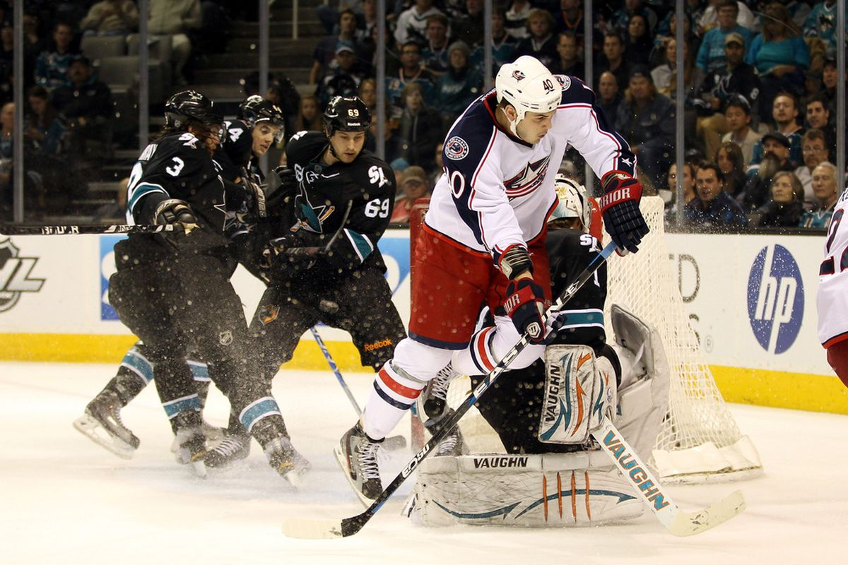 SAN JOSE, CA - JANUARY 05:  Jared Boll #40 of the Columbus Blue Jackets jumps over Thomas Greiss #1 of the San Jose Sharks at HP Pavilion at San Jose on January 5, 2012 in San Jose, California.  (Photo by Ezra Shaw/Getty Images)