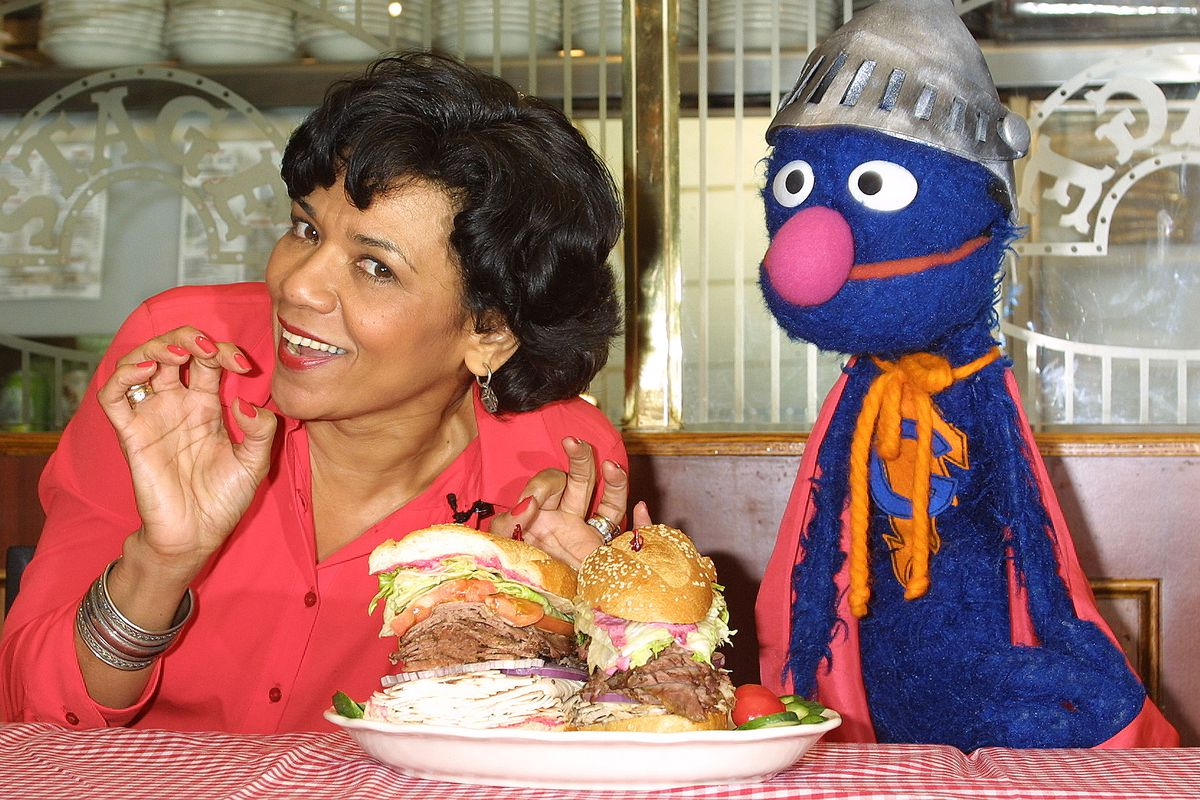 Sonia Manzano hanging out with Grover.