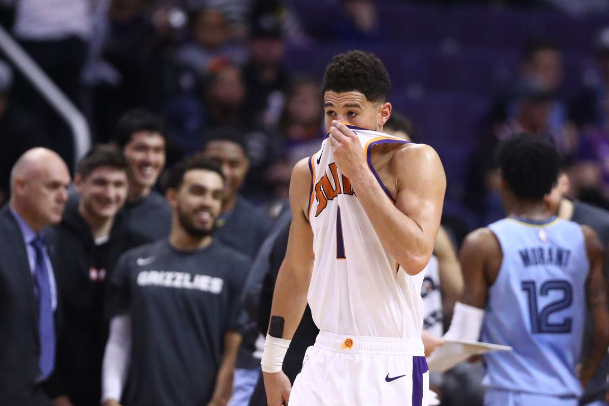 Phoenix Suns guard Devin Booker reacts against the Memphis Grizzlies in the second half at Talking Stick Resort Arena.