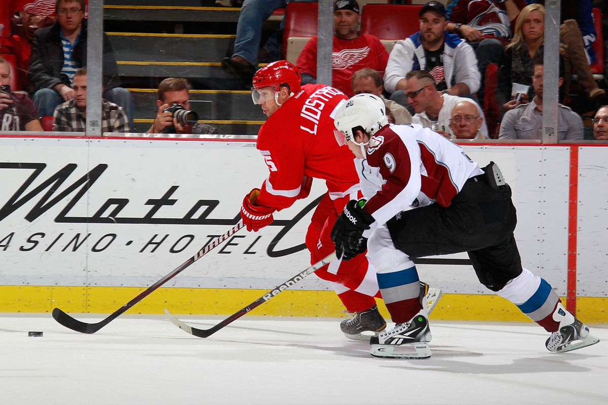 DETROIT, MI - NOVEMBER 08:  Nicklas Lidstrom #5 of the Detroit Red Wings controls the puck in front of Matt Duchene #9 of the Colorado Avalanche at Joe Louis Arena on November 8, 2011 in Detroit, Michigan. (Photo by Gregory Shamus/Getty Images)