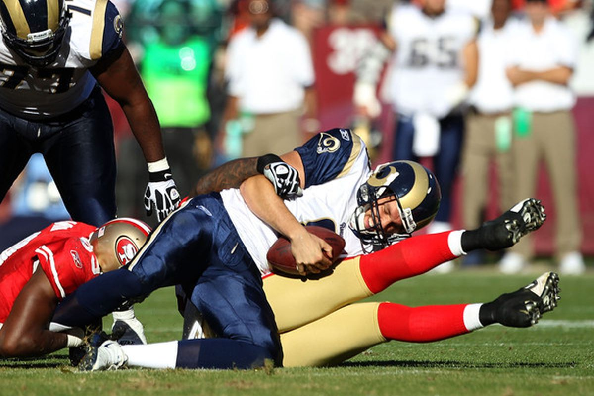SAN FRANCISCO - NOVEMBER 14:  Sam Bradford #8 of the St. Louis Rams is sacked by the San Francisco 49ers at Candlestick Park on November 14 2010 in San Francisco California.  (Photo by Ezra Shaw/Getty Images)