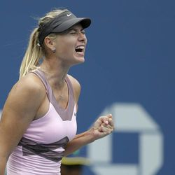 Russia's Maria Sharapova celebrates during her match with Marion Bartoli, of France, in the quarterfinals during the 2012 US Open tennis tournament,  Wednesday, Sept. 5, 2012, in New York.