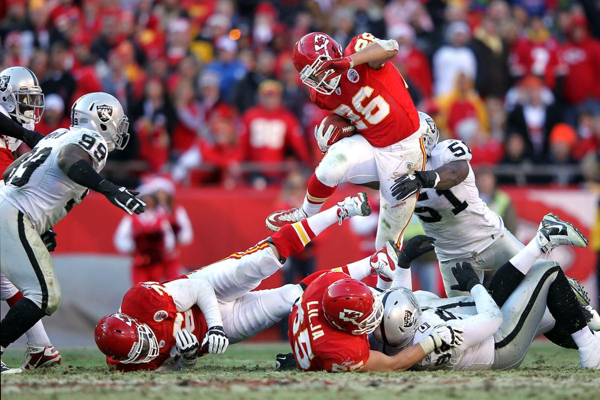 KANSAS CITY, MO - DECEMBER 24:  Jackie Battle #26 of the Kansas City Chiefs carries the ball during the game against the Oakland Raiders on December 24, 2011 at Arrowhead Stadium in Kansas City, Missouri.  (Photo by Jamie Squire/Getty Images)