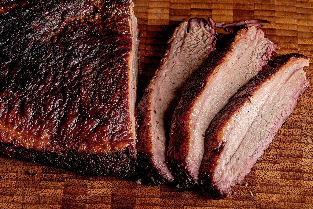 Texas-style brisket gets rubbed with only salt, pepper, and thyme at Money Muscle BBQ