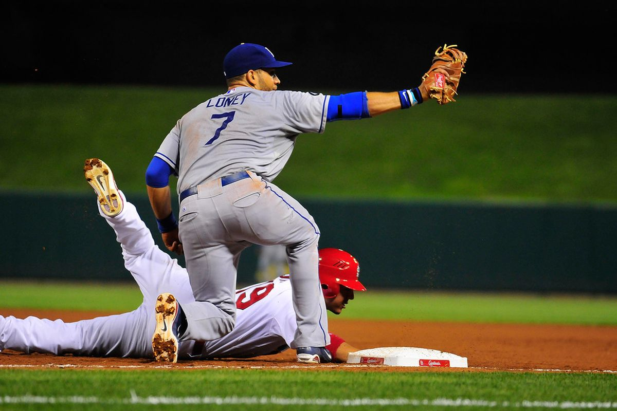 ST. LOUIS, MO - AUGUST 22: James Loney #7 of the Los Angeles Dodgers shows the ball to the umpire after picking off Jon Jay #19 of the St. Louis Cardinals at Busch Stadium on August 22, 2011 in St. Louis, Missouri.  (Photo by Jeff Curry/Getty Images)