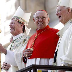 Monsignor Joseph Mayo, left, pastor of the Cathedral of the Madeleine; Bishop John C. Wester of the Catholic Diocese of Salt Lake City; Cardinal William Joseph Levada; and Archbishop George Neiderauer, former Salt Lake bishop, enjoy a laugh after Mass at the cathedral.