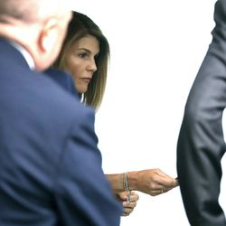 Lori Loughlin enters through the back door at federal court Tuesday, Aug. 27, 2019, in Boston, for a hearing in a nationwide college admissions bribery scandal.