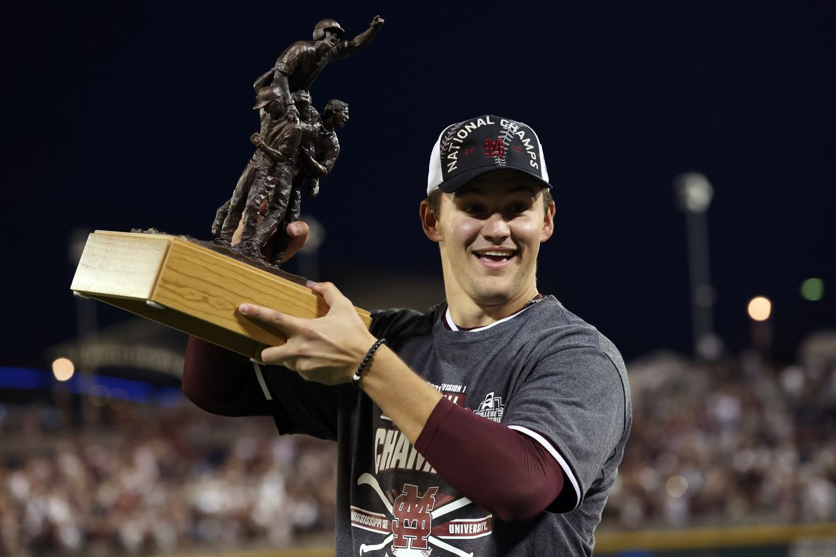 Will Bednar #24 of the Mississippi St. celebrates after being named series MVP after Mississippi St. beat Vanderbilt 9-0 during game three of the College World Series Championship