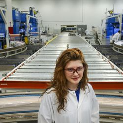 Katlynn Simpson, a senior at Clearfield High School and a member of the Utah Aerospace Pathways Program, stands for a portrait in the radial room at the Orbital ATK manufacturing facility in Clearfield on Thursday, April 20, 2017.