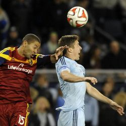Real Salt Lake's Alvaro Saborio and Sporting KC's Matt Besler go up for a header during a game at Sporting Park in Kansas City, Kan., on Saturday, April 5, 2014.