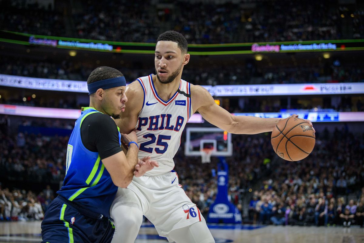 Dallas Mavericks guard Seth Curry defends against Philadelphia 76ers guard Ben Simmons during the second quarter at the American Airlines Center.