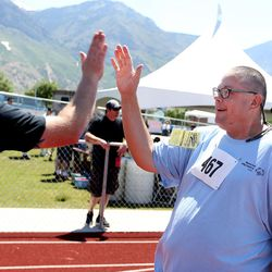 Steve Severt Gallagher, of the Northeast Basin Raptors, is congratulated after competing in the 50-meter race at the Special Olympics Utah's 48th annual Summer Games at Provo High School on Friday, June 2, 2017. Nearly 1,300 athletes will compete during the two-day event with support from nearly 500 coaches and hundreds of volunteers.