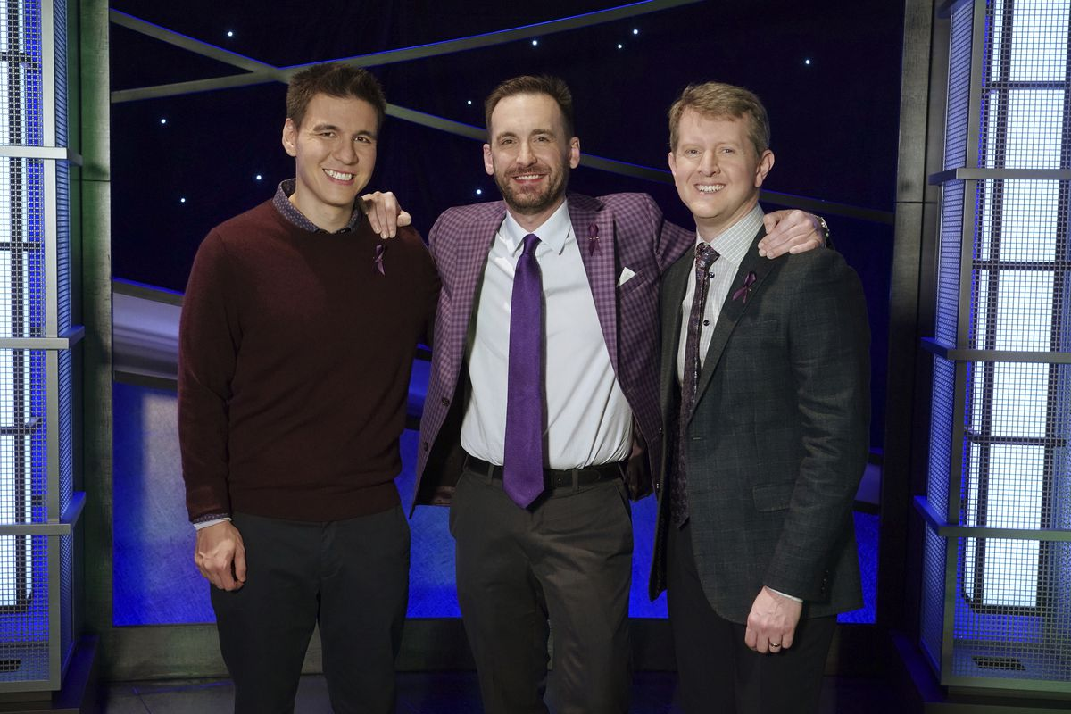 In this image released by ABC, contestants, from left, James Holzhauer, Brad Rutter and Ken Jennings appear on the set of