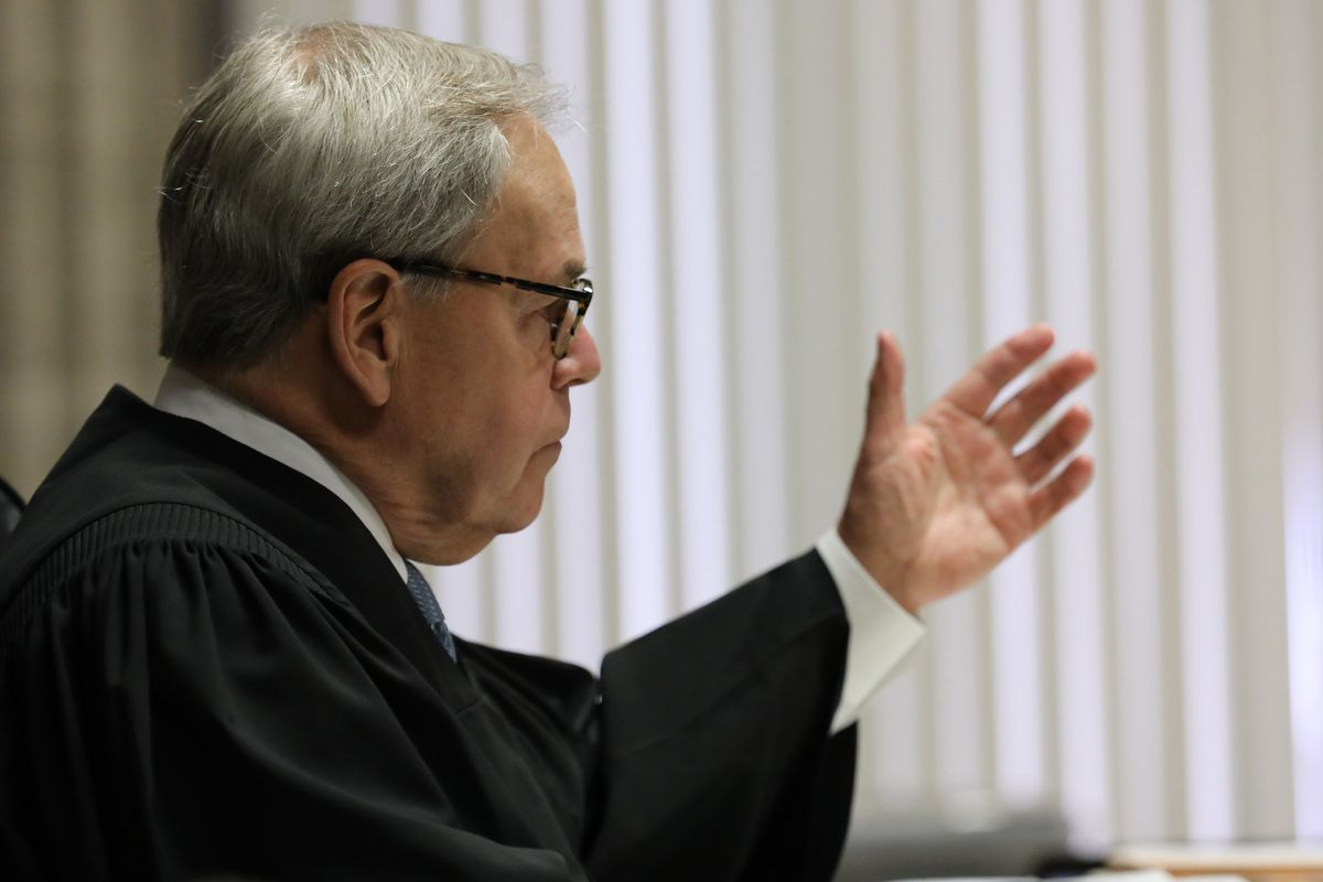 A judge raises his hand to the jury at a courthouse in Chicago, Illinois.