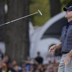 USA's Steve Stricker flips his putter after missing a putt on the 18th hole during a four-ball match at the Ryder Cup PGA golf tournament Saturday, Sept. 29, 2012, at the Medinah Country Club in Medinah, Ill.