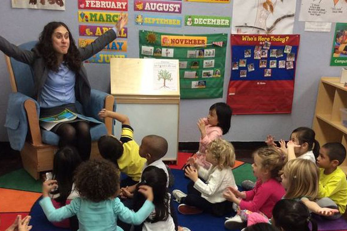 Sophia Pappas reads to a pre-K class.