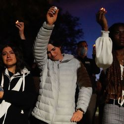 University of Utah students shed tears as they hold up the candles to remember the life of slain student-athlete Aaron Lowe during a candlelight vigil on Wednesday, Sept. 29, 2021 at University of Utah in Salt Lake City.