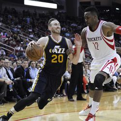 Utah Jazz's Gordon Hayward (20) is fouled by former Houston Rockets' Dwight Howard center (12) in the second half of an NBA basketball game Wednesday, March 23, 2016, in Houston. The Jazz won, 89-87.