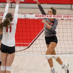 Skyridge's Emma Grant hits the ball toward Mountain Ridge's Rylee Parkinson in a girls volleyball match in Herriman on Tuesday, Sept. 7, 2021.