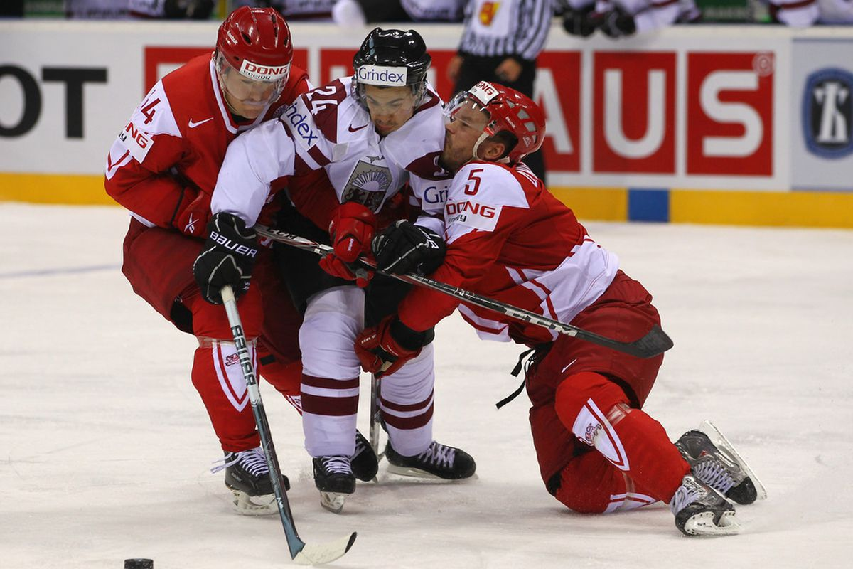 Hey, guys, we're in this together!  Denmark-Latvia photo from the IIHF World Championships. (Photo by Martin Rose/Bongarts/Getty Images)