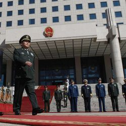 U.S. Defense Secretary Leon Panetta, left, walks with Chinese Defense Minister Liang Guanglie during a ceremony at the Bayi Building in Beijing, China Tuesday, Sept. 18, 2012.