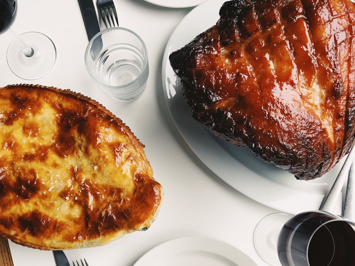 Glazed ham and pheasant, bacon, and root vegetable pie on the Christmas party menu at Llewelyn's restaurant