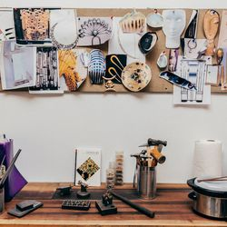 I love this image. It seems to encapsulate a huge part of my work process. I have my mood board with images that inspire and excite me. Faces, hands, art deco architecture, details of furniture, ancient and mystical motifs. Below are some of the necessary