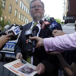 New York police spokesman Paul Browne holds up an original Etan Patz missing person poster while speaking to reporters near an apartment building in Soho, Thursday, April 19, 2012 in New York.  Police officers and FBI agents began tearing apart a New York City basement Thursday as part of a decades-old investigation into the disappearance of 6-year-old Etan Patz, who vanished May 25, 1979, after leaving his family's Manhattan apartment for a short walk to catch a school bus.