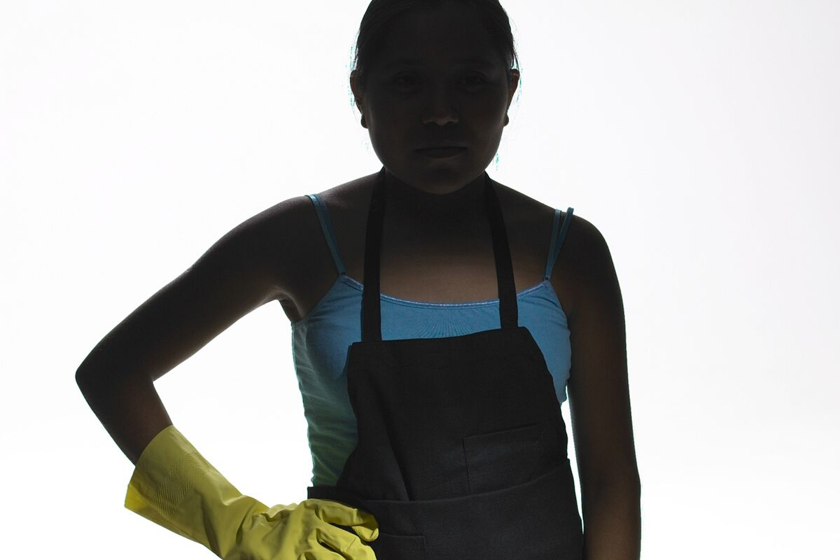 An unidentified undocumented worker poses in 2006.