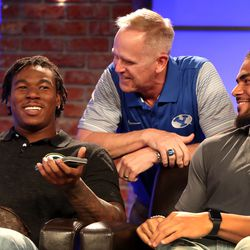 Tom Holmoe, director of athletics at Brigham Young University, (center) visits with former BYU running back Jamaal Williams, of the Green Bay Packers, (left) and former BYU linebacker Fred Warner, of the San Francisco 49ers, during a break in a live broadcast on BYUTV during the BYU football media day in the BYU Broadcasting Building in Provo on Friday, June 22, 2018.