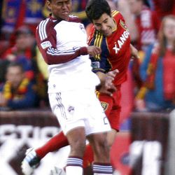 Tony Beltran of Real Salt Lake battles for control of the ball against Jaime Castrillon of the Colorado Rapids during their MLS match up at Rio Tinto Stadium in Sandy Saturday, April 7, 2012.