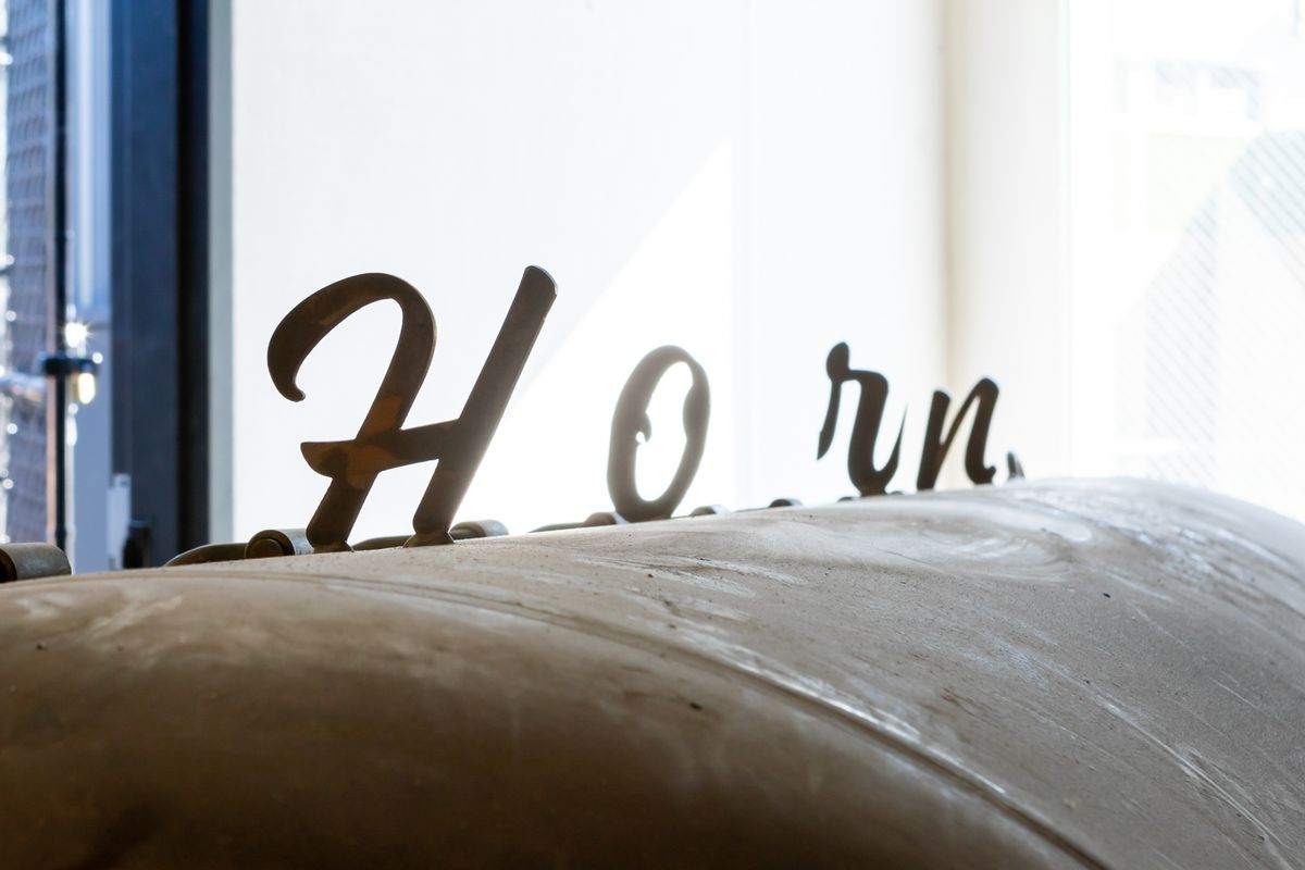 """The top of the restaurant's smoker, with """"Horn"""" spelled out on top"""