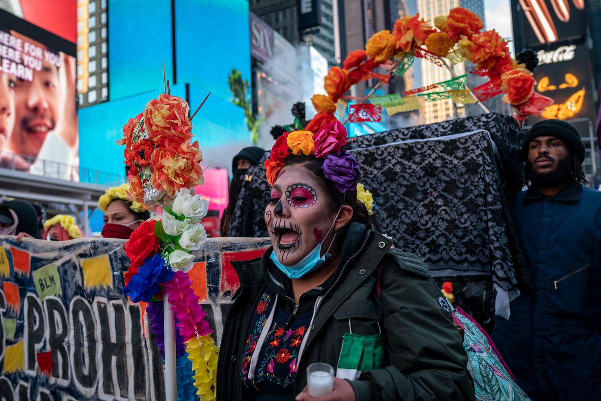 Members of Mexicanos Unidos march through Times Square to honor victims of state-sanctioned violence, Oct. 31, 2020.