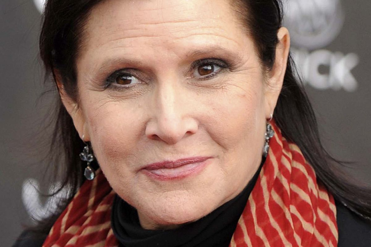 """FILE - In this April 7, 2011 file photo, actress Carrie Fisher appears at the 2011 NewNowNext Awards in Los Angeles. Fisher stars as General Leia in """"Star Wars: The Last Jedi,"""" in theaters on Dec. 15. (AP Photo/Chris Pizzello, File)"""
