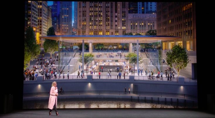 Chicago's new flagship Apple Store includes a glass-box entrance on Pioneer Court with a staircase leading down to the riverfront. | Image courtesy of Apple